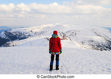 Woman in mountains, watching beautiful landscape - Woman in...