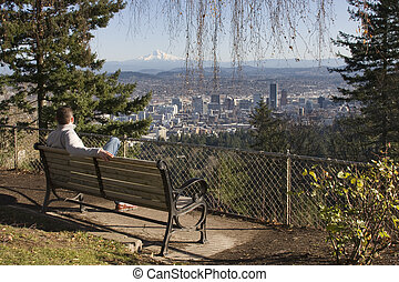 Man overlookng Portland, Oregon from Pittock Mansion - Male...