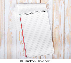 blank realistic spiral Notepad on wooden background