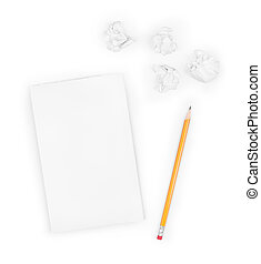 Writing concept - crumpled up paper wads with a sheet of...