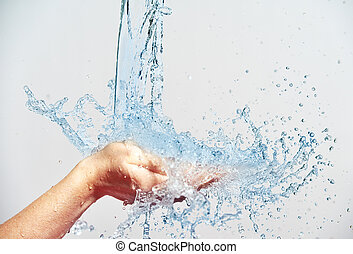 woman hand with water splashes and drops, concept of beauty...