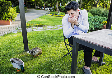 Frightened Young Man Staring at Pair of Ducks - Frightened...