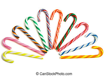 Sweet candy-canes - Colorful candy-canes in a row on a white...