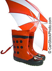 funny cheerful rainboots - Rainboots and umbrella on a white...