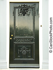 The green door - Door made out of wood with decorations in a...