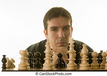 difficult decision - young man playing chess isolated...