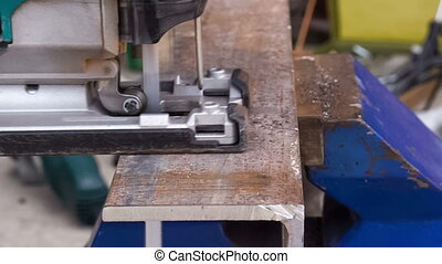 cutting metal workpiece, closeup - workflow of cutting metal...