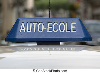 Sign of a french driving school on top of a car -...