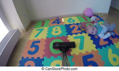 hoovering carpet - Vacuuming hoovering newborn baby colorful...