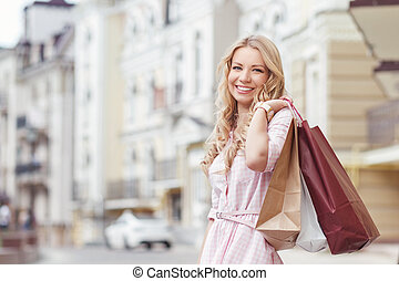 Girl with packages after shopping