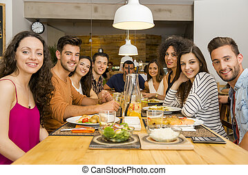 Friends lunching at the restaurant - Multi-Ethnic Group of...