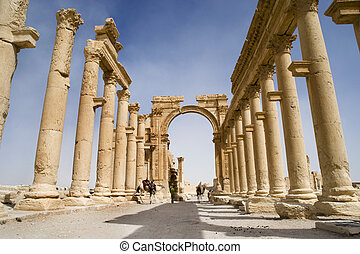 Colonnade in roman ruins of Palmyra, Syria - Lower view of...