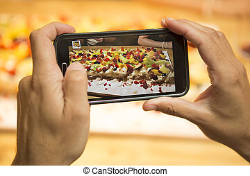 Taking a picture of the dessert