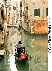 Gondola ride - Riding gondola along one of the many Venetian...