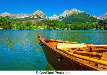 Wooden boat on a beautiful mountain lake in the background...