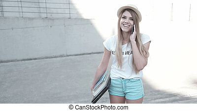 Attractive trendy young female student