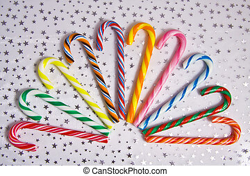 Sweet Candycane - Colorful candycanes on a background with...