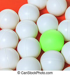 Green ball and white balls, Think different concept