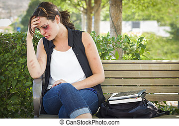 Depressed Bruised and Battered Young Woman on Bench - Sad...