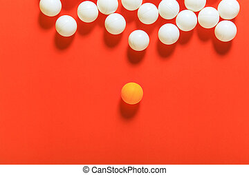 Orange ball and white balls, Think different concept or...