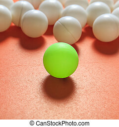 Green ball and white balls, Think different concept or...