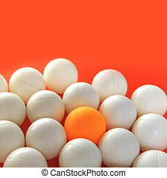 Orange ball and white balls, Think different concept