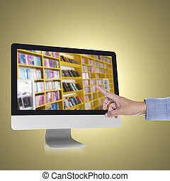 e-book - Hand touching computer monitor with bookshelf on a...