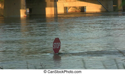 Stop Sign Under Flood Waters - Stop sign under eight feet of...