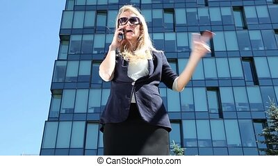 Business woman talking on phone - Business woman talking on...
