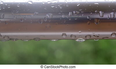 rain drops on balcony railing