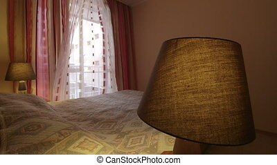Waving curtains in bedroom of a hotel room dolly shot