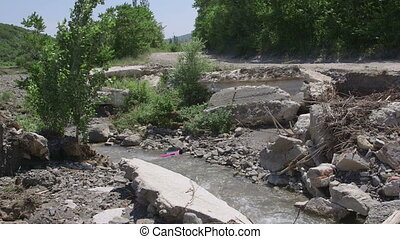 Destroyed concrete bridge after river flooding