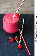 Rasberry smoothie - Glass with rasberry smoothie on the...