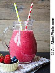 Rasberry smoothie - Glass with rasberry smoothie on the...