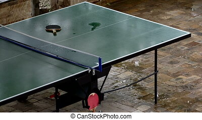 Table tennis table in the rain