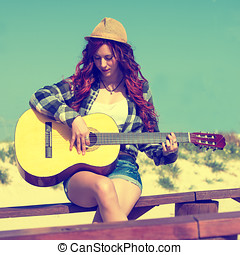 Young Woman playing guitar in pastel colors
