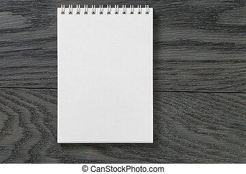 simple blank notepad on rustic wood table, background