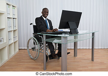 Businessman Working In Office Sitting On Wheelchair -...