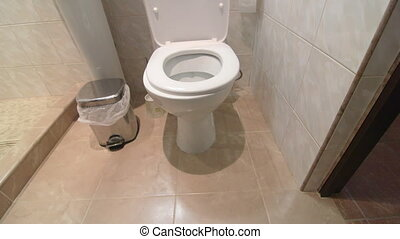 Woman sitting on a toilet