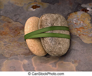 Haiku Marriage - Stones bound together with a long blade of...