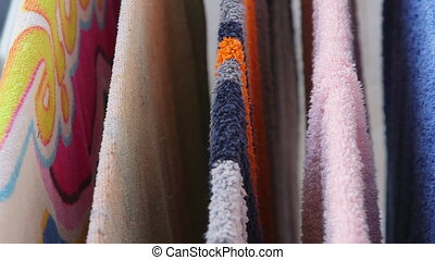 Colorful towels drying on the clothes line closeup