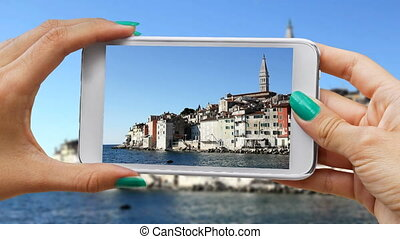 Recording Rovinj with cellphone - Young girl Recording...