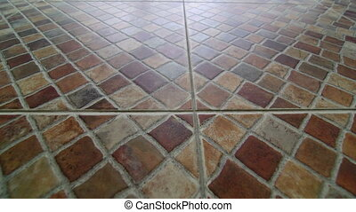 Ceramic tiled floor outdoors dolly shot