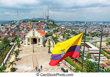 Flag and Church in Guayaquil - Ecuadorian flag on top of...