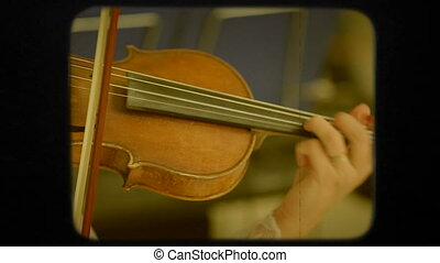Woman Playing the Violon. Retro - Footage of one woman in...
