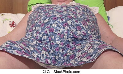 Obese woman suffering shortness of breath lying on bed