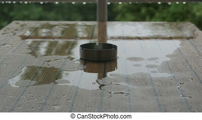 Table with an ashtray in the rain