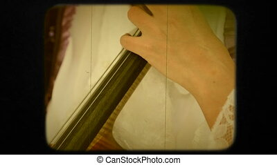 Woman Playing the Violoncello. Retro - Two frames. Close-up...
