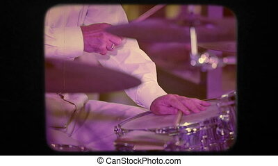 Drummer Playing His Insrument In Concert Retro - Close up of...