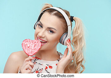 Attractive young woman is relaxing with candy - Beautiful...